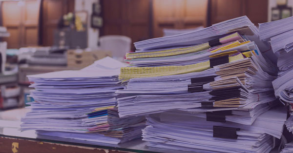 Tax Documents Retention Guidelines to decide what to do with documents on a desk.