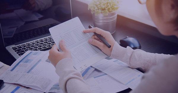 A Woman Simplify Filing Tax Returns at a desk