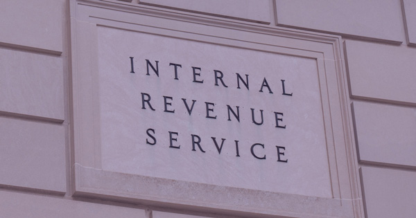 Federal Income Tax Deadline Extended Show in front of the IRS Building